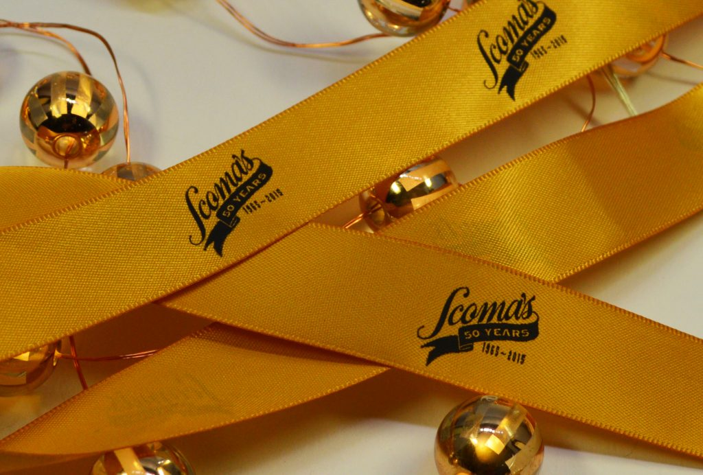 black print on ribbon, custom logo ribbon, yellow ribbon, logo ribbon, printed ribbon, promotional ribbon, custom logo printing, satin logo, ribbon for events, ribbon for promotional products, ribbon for gift wrapping