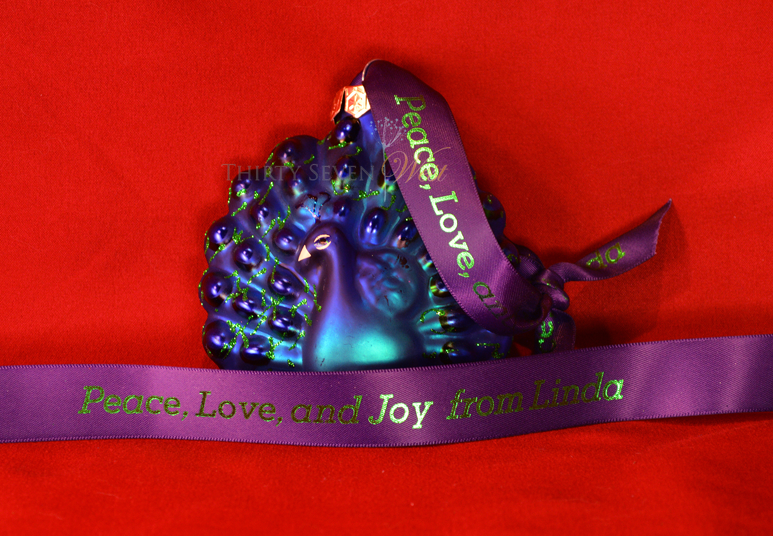 Branding ribbon to set you apart, Branding ribbon to wrap gift boxes Christmas gifts for companies, Christmas ornament gift with personalized hanger, Christmas ornament with custom logo ribbon, Christmas ornament with logo ribbon, Christmas ornament with personalized ribbon as hanger, Christmas Ribbon, Custom Logo ribbon to wrap gift box Custom logo ribbon to wrap gift boxes Custom logo ribbon to wrap gift box for the holidays Custom printed ribbon, Custom ribbon, Customized Ribbon, Festive colors, First class branding, Holiday colors Logo ribbon to wrap gift box Logo ribbon to wrap gift box for holidays Luxury branding with double face satin ribbon, Metallic green ink, Ornament hanger, Ornament with Christmas ribbon with custom logo, Peacock ornament, Personalized Christmas Ribbon, Personalized printed ribbon, Personalized Ribbon with message, Personalized Ribbon with messages, Personalized Ribbon with sayings, Personalized Ribbons, Personalized ribbon to wrap gift boxes personalized satin ribbon, Personalized printed satin ribbon Printed ribbon, Purple ribbon, Purple satin ribbon with Metallic Green ink, Red Ribbon, Ribbon in holiday colors